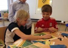 Ученики Класса Го в Павловской гимназии решают задачи Военно-стратегической игры Го