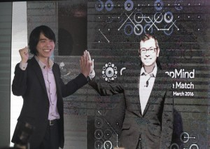 South Korean Lee Sedol, the world champion of the ancient Chinese board game Go, left, poses with an image of Demis Hassabis, CEO at Google DeepMind that developed AlphaGo, on a screen though a video conference from London, during a press conference in Seoul, South Korea, Monday, Feb. 22, 2016. Lee will prevail in a match with Google's computer program AlphaGo next month, but he's not so sure he would be able to do it a year later. AlphaGo defeated a professional Go player for the first time in October, something that experts had predicted would take a decade. The match, described in a paper released in the journal Nature last month, marked a significant advance for development of artificial intelligence. (AP Photo/Ahn Young-joon)